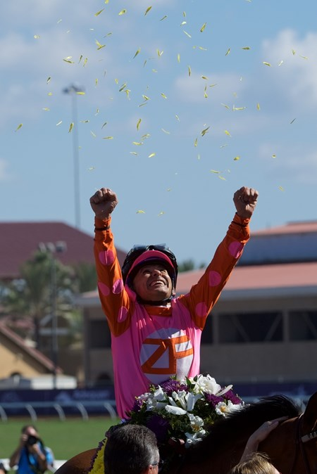 Mike Smith celebrates winning the 14 Hands Juvenile Fillies atop Caledonia Road at Del Mar on November 4, 2017.