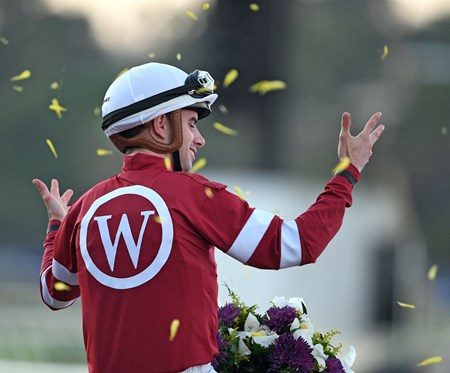 Jockey Florent Geroux celebrates his Breeders' Cup Classic win