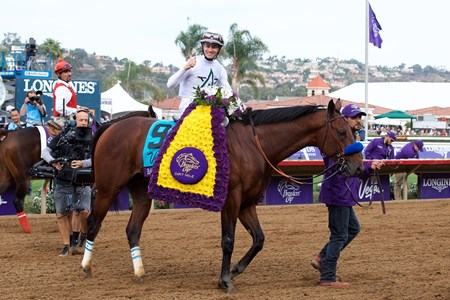 Flavien Prat celebrates winning the Breeders Cup Dirt Mile atop Battle of Midway on November 3, 2017.