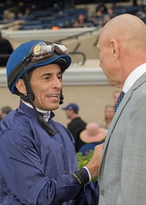 Jockey John Velazquez, left, celebrates with trainer Anthony Dutrow, right, after Mo Town's victory in the Grade I, $300,000 Hollywood Derby, Saturday, November 25, 2017 at Del Mar Thoroughbred Club, Del Mar CA.