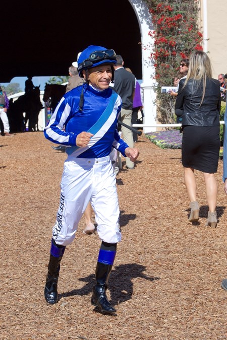 Mike Smith jogs into the paddock before the Breeders Cup Filly and Mare Turf on November 4, 2017