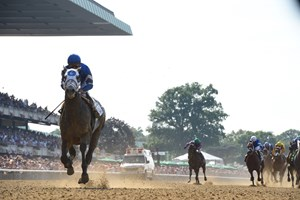 Frosted wins the 2016 Metropolitan Handicap with a 14 1/4-length romp in stakes-record time