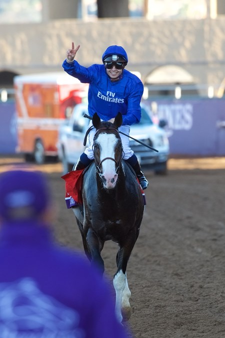 Mickael Barzalona celebrates after winning the Breeders Cup Turf atop Talismanic on November 4, 2017.
