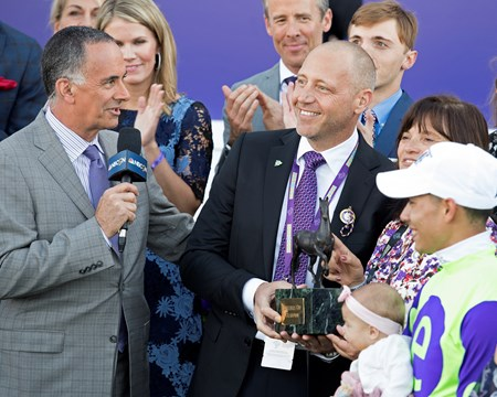 Owner Edwards with trophy Good Magic wins the Breeders Cup Juvenile on November 4, 2017.