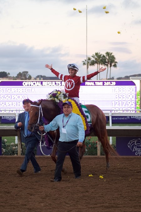 Florent Geroux celebrates after winning the Breeders Cup Classic atop Gun Runner on November 4, 2017