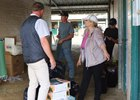 Debby Baltas helps backstretch workers at barn PP in the Del Mar barn area