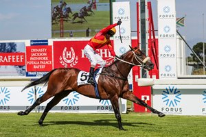 MJ Byleveld celebrates as Tap o' Noth soars under the line in the Cape Guineas at Kenilworth Park