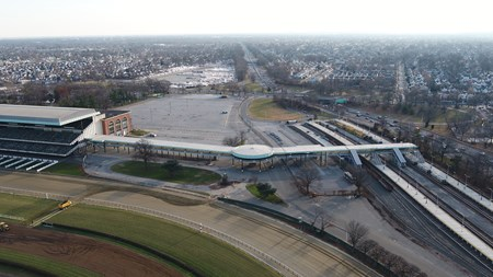 December 19, 2017- Belmont Park  - Governor Andrew M. Cuomo will announce on Wednesday December 20, 2017 that 43 acres of state-owned land at the Belmont Park race course will be developed into an 18,000 seat hockey arena by the New York Islanders. Pictured is an aerial view of the parking lot, right, in Belmont Park where the new arena will be constructed. The location is key as it is adjacent to the newly renovated Belmont Park LIRR station, seen in the foreground