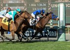 Midnight Crossing (inside) just holds off Elysea's World to win the Robert J. Frankel Stakes at Santa Anita Park