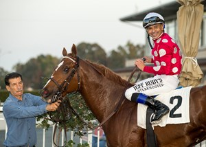 Intimidate and his groom along with jockey Mike Smith after winning the King Glorious at Los Alamitos Race Course