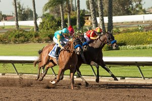 McKinzie (right) wins the Los Alamitos CashCall Futurity Stakes via DQ