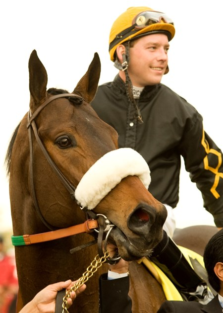 Papa Clem and jockey Tyler Baze pose for their picture after winning the Grade II, $150,000 San Fernando Stakes, Saturday, January 16, 2010 at Santa Anita Park, Arcadia CA.