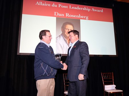 Dan Rosenberg (left) receives the Allaire du Pont Leadership Award from Thoroughbred Charities of America president Mike McMahon