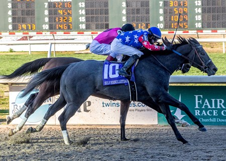 1/13/2018. -  Stronger Than Ever with Florent Geroux aboard gets a head in front of Wonder Gadot to capture the Silverbulletday Stakes at Fair Grounds..
