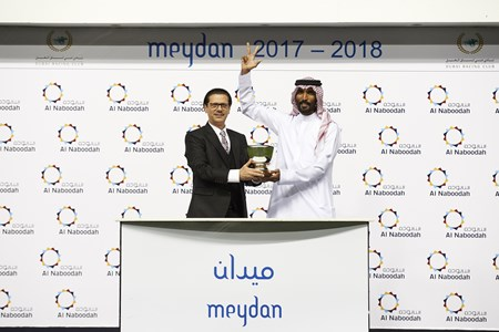 Faiz Al Turkamani, accepts the trophy for the Al Naboodah Travel Handicap, from Nasir Jamal Khan, Chief Executive Officer (CEO), Al Naboodah Travel on January 20th, 2018
