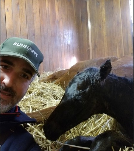 First reported foal by Claiborne Farm's Runhappy was bred by Ashview Farm, near Versailles, Ky. Gray Lyster is shown here with the filly born Jan. 14