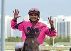 Jockey Luis Saez celebrates after his seventh win on the Jan. 24 Gulfstream Park card