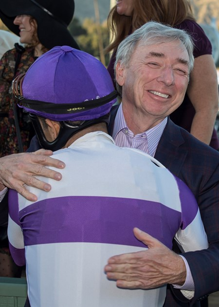 Owner J. Paul Reddam, right, has a hug for jockey Mario Gutierrez, left, in the winner's circle after Mopotism's victory in the G2, $200,000 La Canada Stakes, Saturday, January 13, 2018 at Santa Anita Park, Arcadia CA.