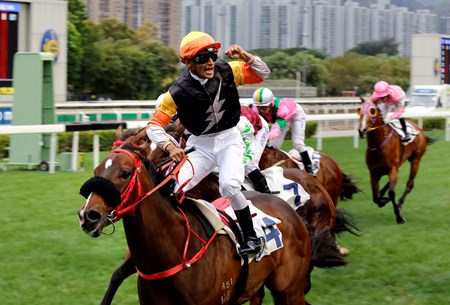 Karis Teetan celebrates after winning the G3 Bauhinia Sprint Trophy Handicap (1000m) aboard Premiere.