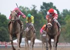 Blind Luck (outside) wins the 2010 Alabama Stakes over Havre de Grace (inside) at Saratoga Race Course