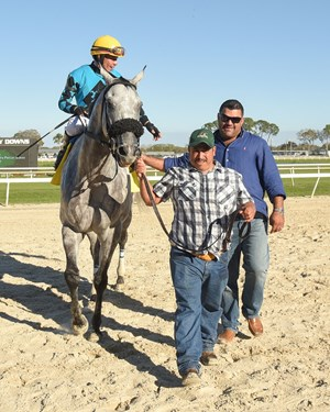 Jorge Navarro (right) walks to the winner's circle with X Y Jet after the Pelican Stakes at Tampa Bay Downs