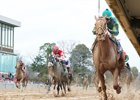 Hawaakom races down the rail in the Razorback Handicap to win in the mud at Oaklawn Park