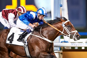 Janoobi wins the Zabeel Mile at Meydan Racecourse