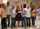 Nick Vaccarezza accepts a check from Acacia Courtney at the fundraiser. Carlo Vaccarezza is third from left.