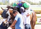 Javier and Abel Castellano embrace after Nothins Free's win