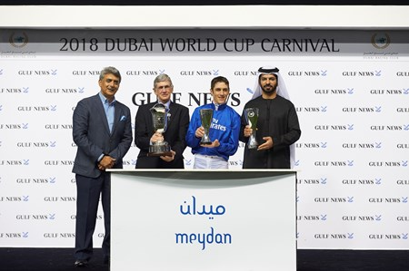 Christophe Soumillon, Saeed bin Suroor and  Brian Powell accept trophies for the 2018 Al Maktoum Challenge from Rajeev Khanna