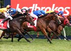 Hartnell (center, blue cap) wins the C.F. Orr Stakes at Caulfield Feb. 10