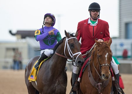 Magnum Moon and Luis Saez after winning the Rebel at Oaklawn Park on March 17, 2018.