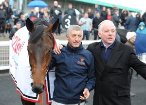 Gronkowski in the winners circle after the Burradon Stakes with trainer Jeremy Noseda (right)