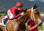 Tyler Baze celebrates with Itsinthepost after their San Luis Rey Stakes win at Santa Anita Park