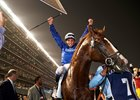 William Buick celebrates aboard Hawkbill after their Dubai Sheema Classic win at Meydan