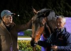 Gronkowski, with Amer Abdulaziz (left), after winning the Road to the Kentucky Derby Conditions Stakes at Kempton