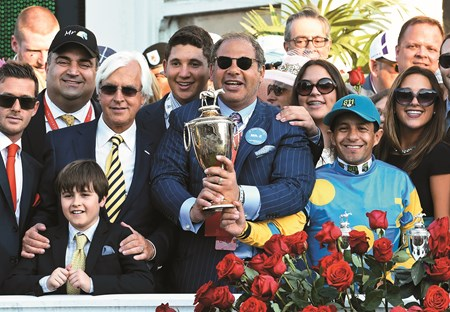 Owner Ahmed Zayat holds the winner's trophy and is joined in the winner's circle with trainer Bob Baffer left and jockey Victor Espinoza, right after winning  the 141st Kentucky Derby on American Pharaoh  May 2, 2015 at Churchill Downs in Louisville, Kentucky.      