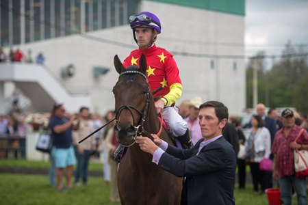 Rodolphe Brisset leads Quip after the colt's win in the Tampa Bay Derby at Tampa Bay Downs