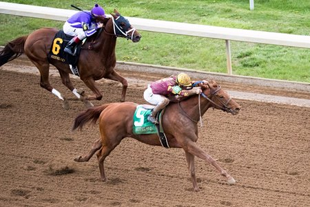 Rated R Superstar moves past Chip Leader in the Ben Ali Stakes at Keeneland