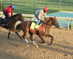 Flameaway clears workmate Ride a Comet while clocking five furlongs in 1:00 2/5 at Churchill Downs