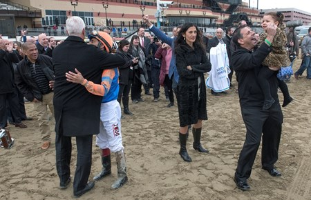 Celebration all around after Vino Rosso  wins the 94th running of The Wood Memorial at Aqueduct Saturday April 7, 2018 in Ozone Park, N.Y.