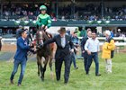 Peter Brant (right) leads Sistercharlie to the winner's circle after her Jenny Wiley Stakes score at Keeneland