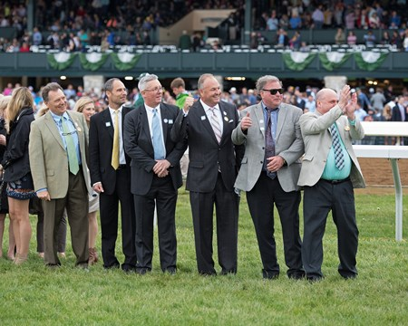 Owners group:  Devant Latham, left, with owners including Kirk Godby with Don't Tell My Wife Stables (4th from right). My Boy Jack with Kent Desormeaux up wins the Stonestreet Lexington (G3) at Keeneland on April 14, 2018 Keeneland in Lexington, Ky.