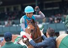 Assistant trainer David Meah congratulates jockey Corey Nakatani after Gas Station Sushi won the Beaumont at Keeneland
