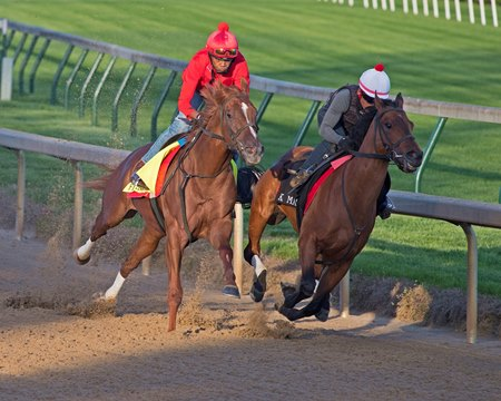 Flameaway (outside) works four furlongs in company at Churchill Downs