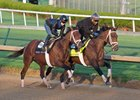 Magnum Moon (inside) works four furlongs in :47 2/5 at Churchill Downs