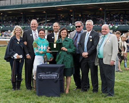 PRES: presenter Barbara Banke (green) and Kirk Godby, second right. My Boy Jack with Kent Desormeaux up wins the Stonestreet Lexington (G3) at Keeneland on April 14, 2018 Keeneland in Lexington, Ky.