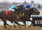 Westwood (inside) keeps a head in front to score at Aqueduct