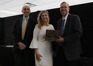From left, Peter Sacopulos, secretary of ITOBA, Rachel McLaughlin, on-air racing analyst and host of the ITOBA banquet, and Jon Schuster, vice president and general manager of racing.