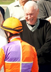 B. Wayne Hughes and jockey Gary Stevens after Spendthrift Farm's Beholder won the 2015 Santa Lucia Stakes